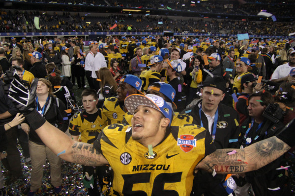 Shane Ray (56), who scored the game-winning touchdown for Missouri, celebrates on the field after the game.